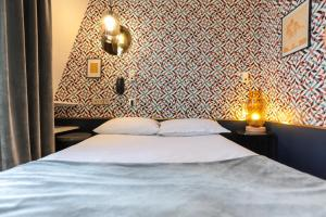 A bed or beds in a room at Oops! Latin quarter by Hiphophostels