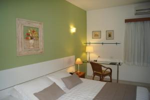 Cama ou camas em um quarto em Pousada Paisagem