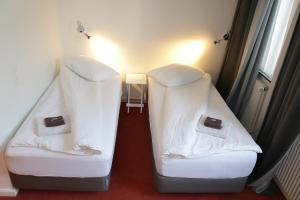 A bed or beds in a room at Park Apartaments