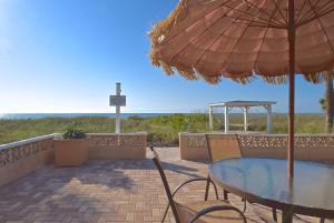 A balcony or terrace at A Beach Retreat on Casey Key