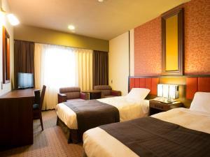 A bed or beds in a room at Hotel Pearl City Akita Kawabata