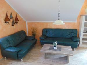 Ein Sitzbereich in der Unterkunft FeWo Nixentraum + FeWo Strandlounge Louie