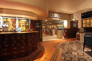 The lounge or bar area at Half Moon, Sherborne by Marston's Inns