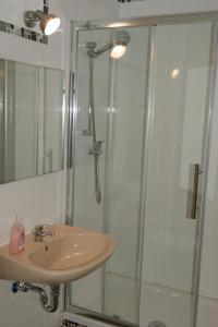 Ванная комната в Apartment-Hotel Rackwitz