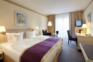 Ein Bett oder Betten in einem Zimmer der Unterkunft Best Western Hotel Helmstedt am Lappwald
