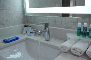 A bathroom at Holiday Inn Express & Suites Toronto Airport West, an IHG Hotel