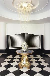 A seating area at M Glamour Hotel