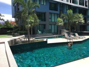 The swimming pool at or near Acqua Condotel No.31/284