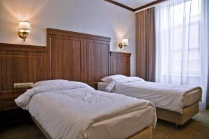 Кровать или кровати в номере Hotel Retro