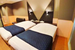 A bed or beds in a room at Hotel Times Inn 24