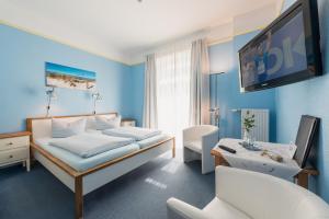 Кровать или кровати в номере Hotel am Wind