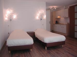 Een bed of bedden in een kamer bij Hotel Studio Bosch Duin Strand