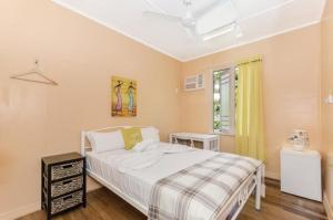 A bed or beds in a room at Civic Guesthouse
