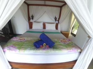 Un ou plusieurs lits dans un hébergement de l'établissement The BBQ Guest House