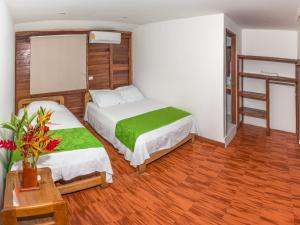 A bed or beds in a room at Playa de Oro Lodge