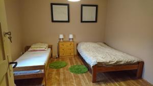 Łóżko lub łóżka w pokoju w obiekcie Szlak Wielkich Jezior
