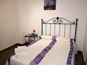 Hostal Martin Vares tesisinde bir odada yatak veya yataklar