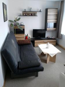 Ein Sitzbereich in der Unterkunft Ferienwohnung Mey
