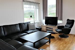 A seating area at RIBO Apartment Riksgränsen