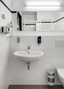 Um banheiro em ao Hotel Venezia Mestre