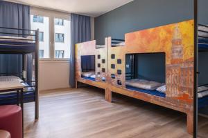 Uma ou mais camas em beliche em um quarto em ao Hotel Venezia Mestre