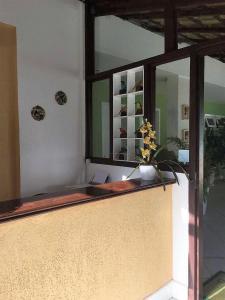 The lobby or reception area at Pousada Anambé