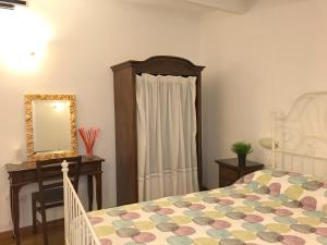 A bed or beds in a room at Il Labirinto B&B