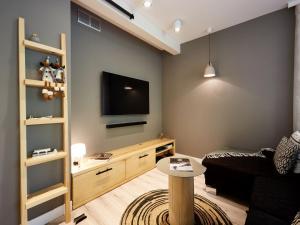 Telewizja i/lub zestaw kina domowego w obiekcie Apartamenty Tatry Garden&Spa