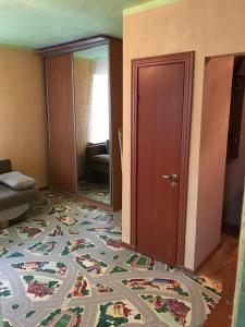 Кровать или кровати в номере Апартаменты на Богдана Хмельницкого