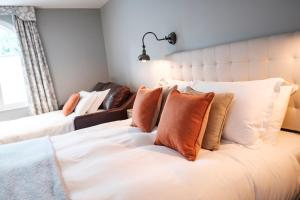 A bed or beds in a room at The Princess Royal