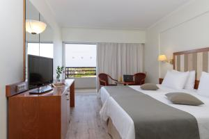 Телевизор и/или развлекательный центр в Best Western Plus Hotel Plaza