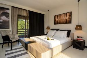 Ένα ή περισσότερα κρεβάτια σε δωμάτιο στο Dion Palace Resort and Spa