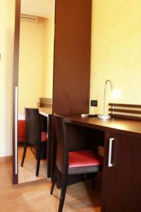 A kitchen or kitchenette at San Max Hotel