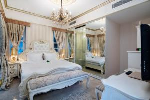 A bed or beds in a room at Elegance East Hotel