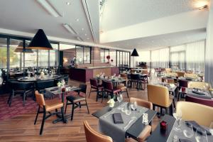A restaurant or other place to eat at Mercure Orange Centre A7/A9