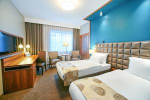 A bed or beds in a room at Holiday Inn Krakow City Centre, an IHG Hotel