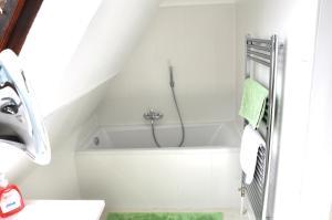 Ein Badezimmer in der Unterkunft Romeo Caviar Suiten