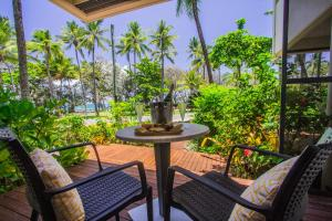 A balcony or terrace at Port Douglas Peninsula Boutique Hotel - Adults Only Haven