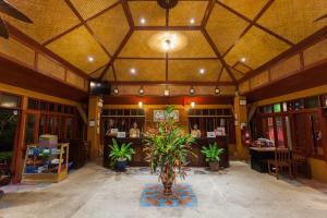 The lobby or reception area at PP Erawan Palms Resort- SHA Plus