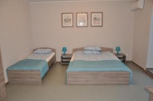 Кровать или кровати в номере Гостиница Электростальская