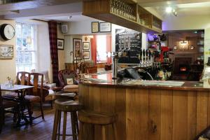 The lounge or bar area at The Wheatsheaf Inn