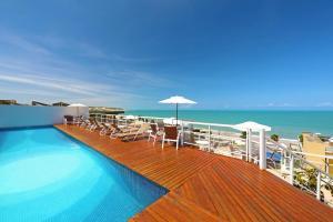 The swimming pool at or near Vip Praia Hotel