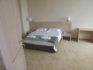 Кровать или кровати в номере Гостиничный комплекс Теплое Море