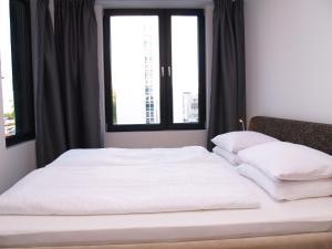 A bed or beds in a room at Elegant Apartment Miletičova
