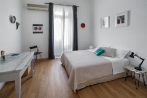A bed or beds in a room at A Casa di Adri