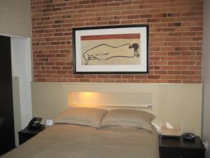 Un ou plusieurs lits dans un hébergement de l'établissement Le Relais Lyonnais