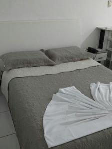 Cama ou camas em um quarto em Flat Avenida Oceânica Barra