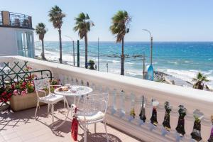 A balcony or terrace at Hotel Villa La Brise