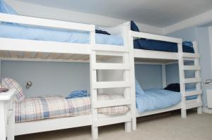 A bunk bed or bunk beds in a room at The Sun Inn