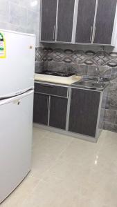 A cozinha ou cozinha compacta de Rahati ApartHotel